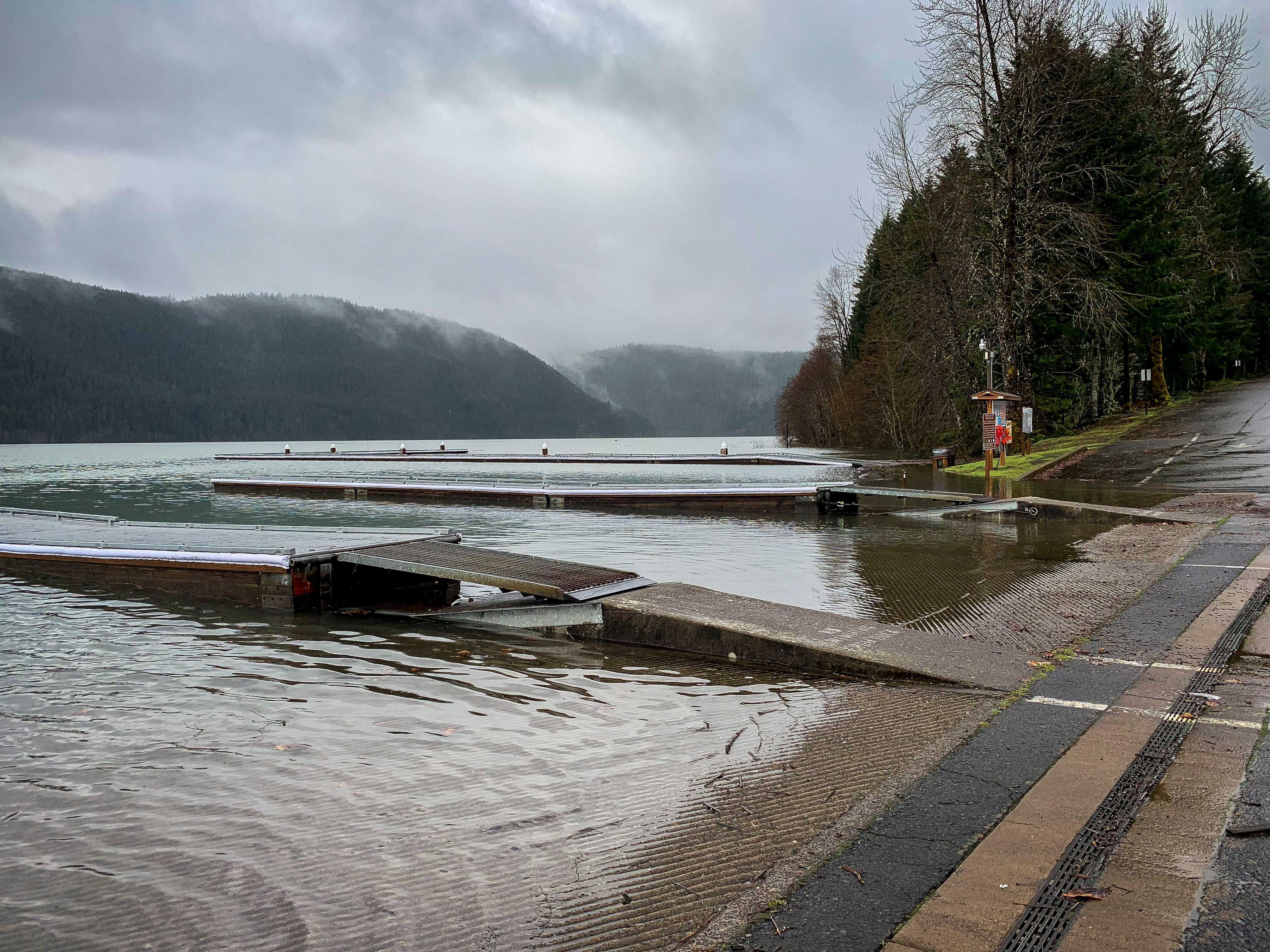 Due to a combination of rain and snow melt, Detroit Lake has risen 45 feet in five days to reach 'full pool' with weeks until the summer season officially begins. The summer boat docks are the only ones visible with the winter area completely submerged.
