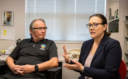 George Lovato, Washington County death investigator, left, and Kimberly Repp, the county's health program supervisor and epidemiologist, talk about suicide during an interview in the medical examiner's office.