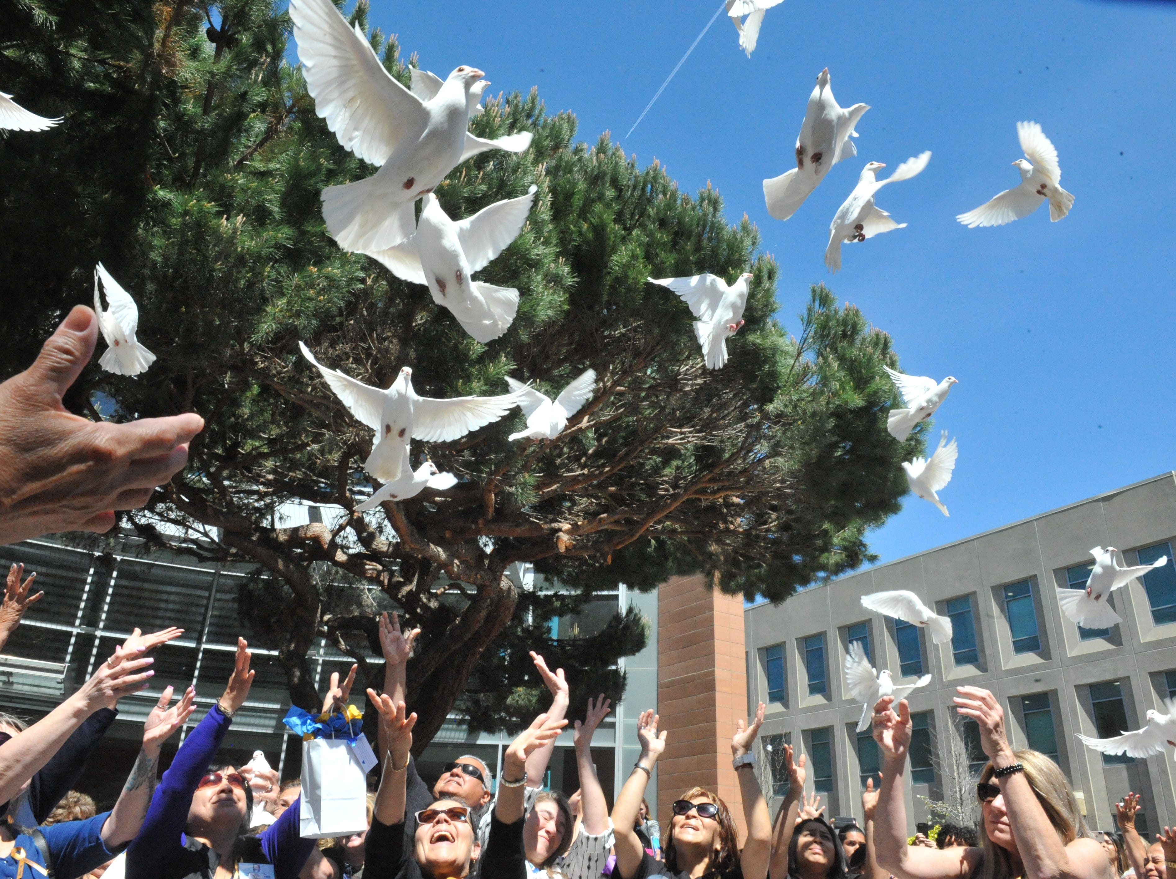 Friends and family release doves during National Crime Victims' Rights Week in honor of their loved ones who were lost to violence. April 12, 2019.