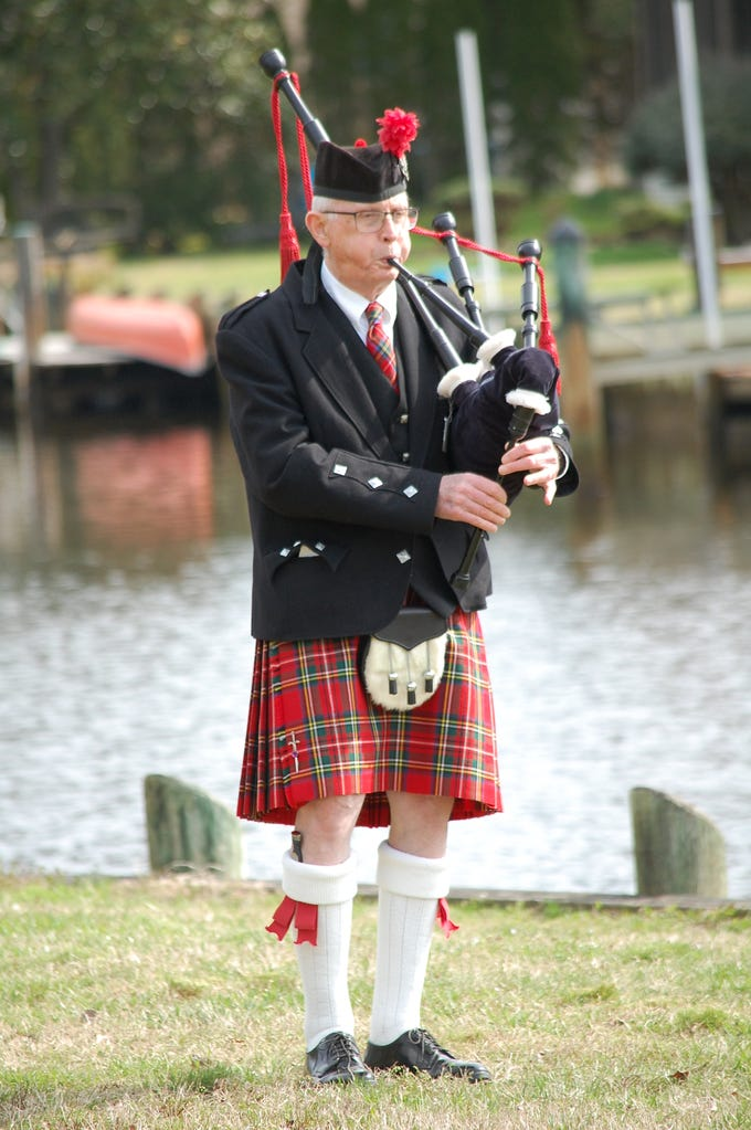 Pat Harmon plays the bagpipes for the Ocean Pines Garden Club's Arbor Day Memorial Celebration in Pintail Park.