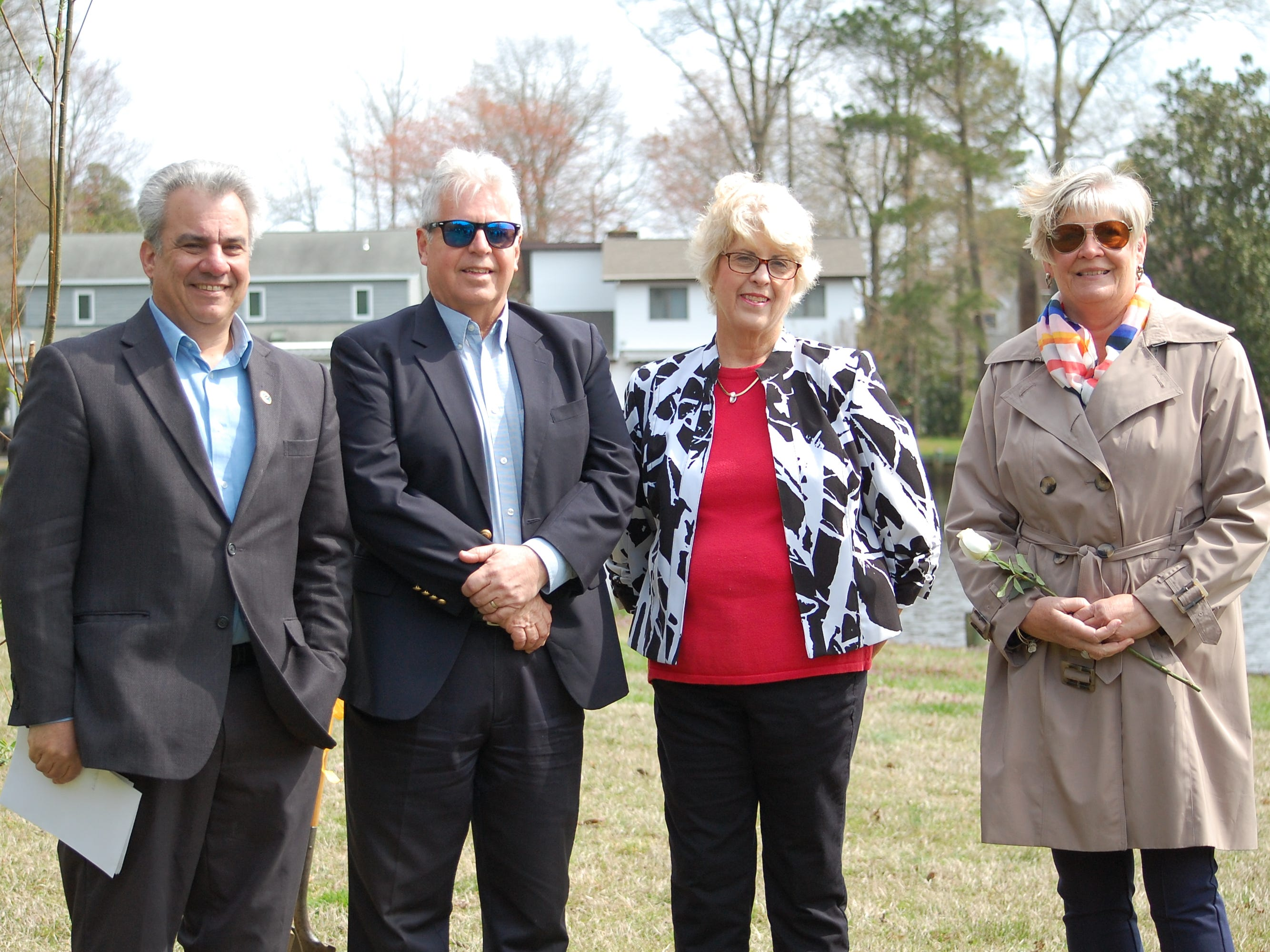 At the memorial ceremony at Pintail Park in Ocean Pines are, from left,  Worcester County Commissioner Chip Bertino, Ocean Pines Board President Doug Parks, event organizer Ann Shockley and Ocean Pines Garden Club President Linda Baker.