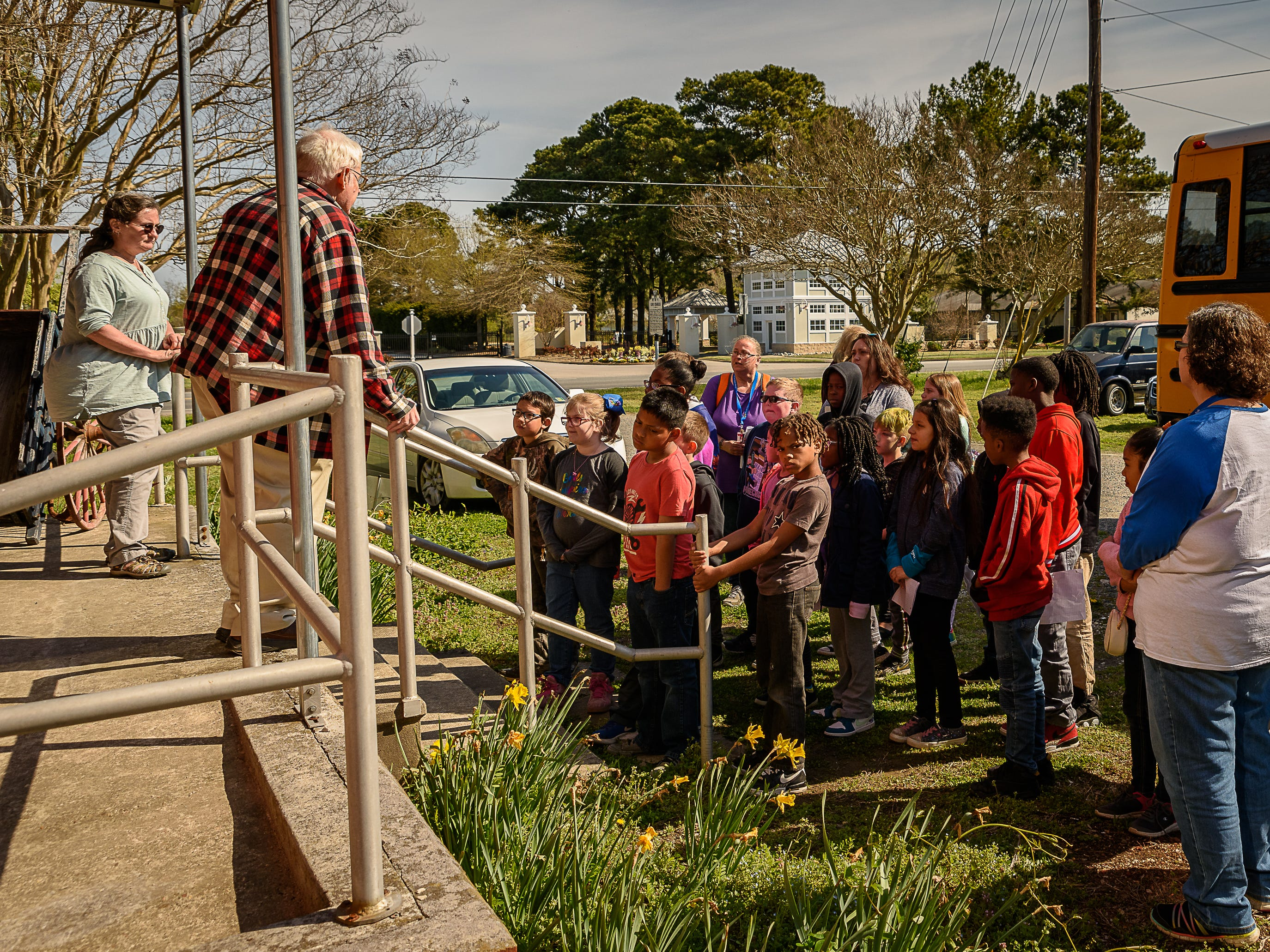 Kimb Denny and Jerry Doughty from the Cape Charles Museum and Welcome Center greet Kiptopeke Elementary School 4th graders.