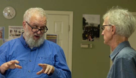 John Perkins and Jeff Welburn discuss plans at an Allendale Strong meeting April 11, 2019.