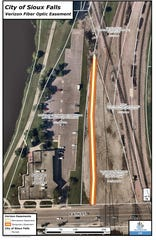 A fiber optic line from Verizon Wireless cuts through a portion of the city-owned rail yard land north of Sixth Street.