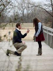 Jeremy Olinda proposes to Madison Weidner on the bridge.