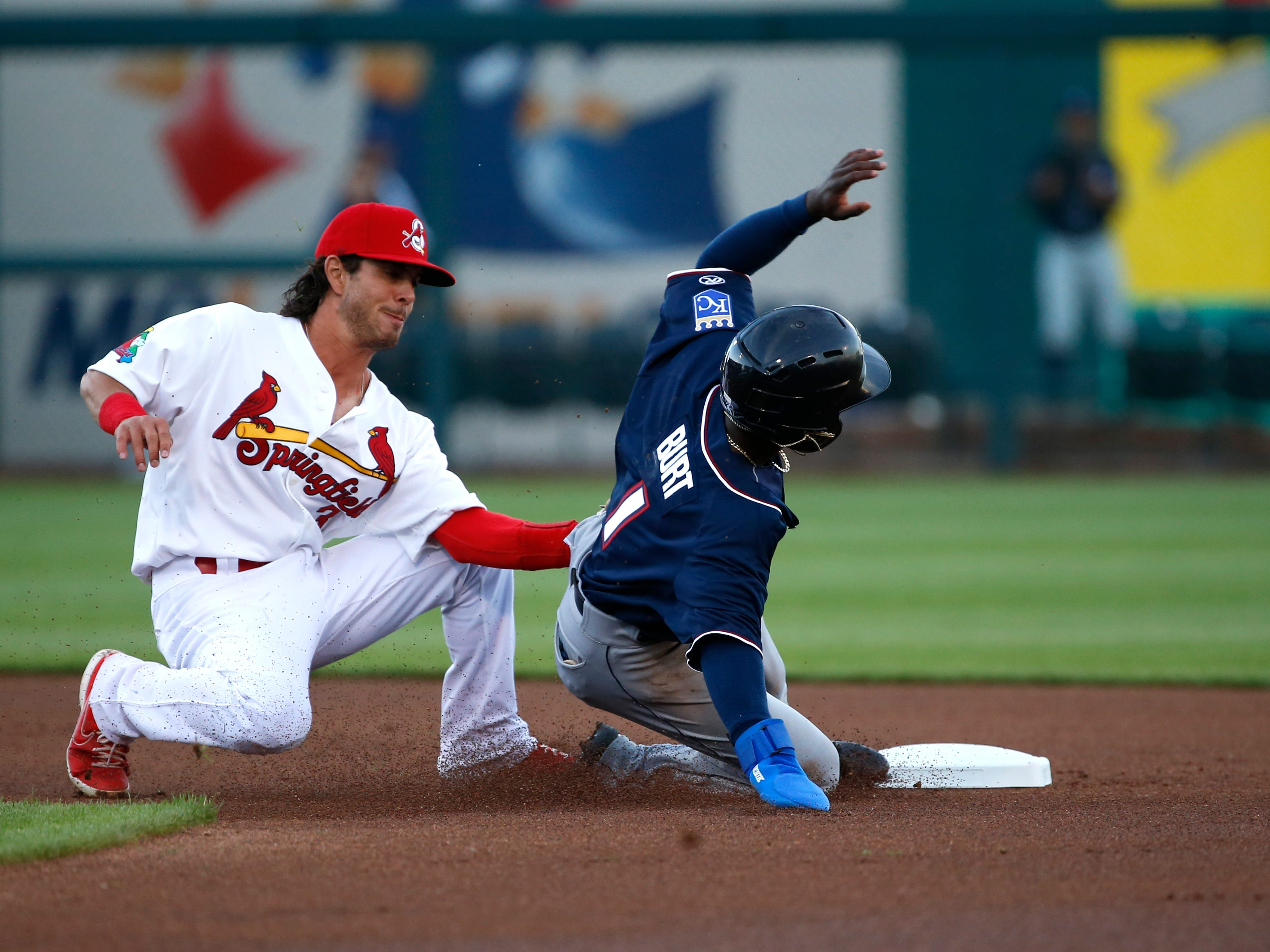 Springfield Cardinals shortstop Kramer Robertson tags out Northwest Arkansas Natural D.J. Burt while trying to steal second at Hammons Field on Thursday, April 11, 2019 during the Cardinals home opener.