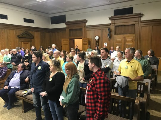 Eden Village COO Nate Schlueter asked supporters to stand Thursday night at the Springfield Planning and Zoning Commission meeting. The commission approved a rezoning request from Eden Village. The matter goes to City Council for public hearing on May 6.
