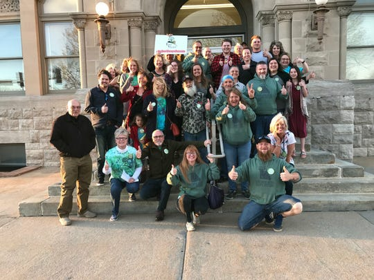 Eden Village supporters and residents pose for a photo following the Planning and Zoning Commission's decision to approve a zoning change on a donated piece of land in northwest Springfield. If city council also approves the change, the land will become Eden Village's second community of tiny homes for homeless people.