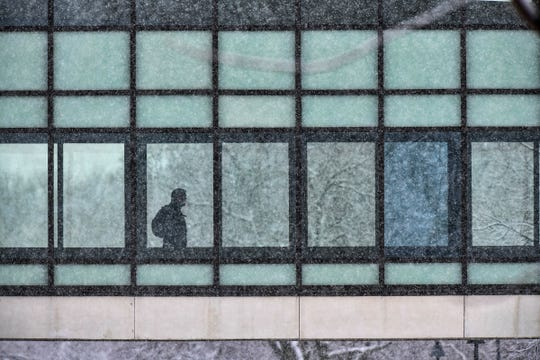 Students use the skyway to walk between buildings as heavy snow falls Friday, April 12, at St. Cloud State University.