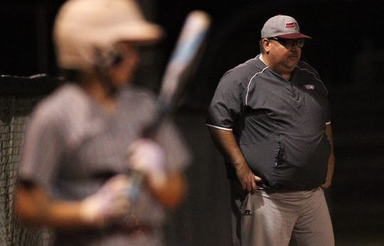 Franklin County softball coach Scott Collins watches as Chiles won 6-1 against visiting Franklin County on Wednesday, April 10, 2019.