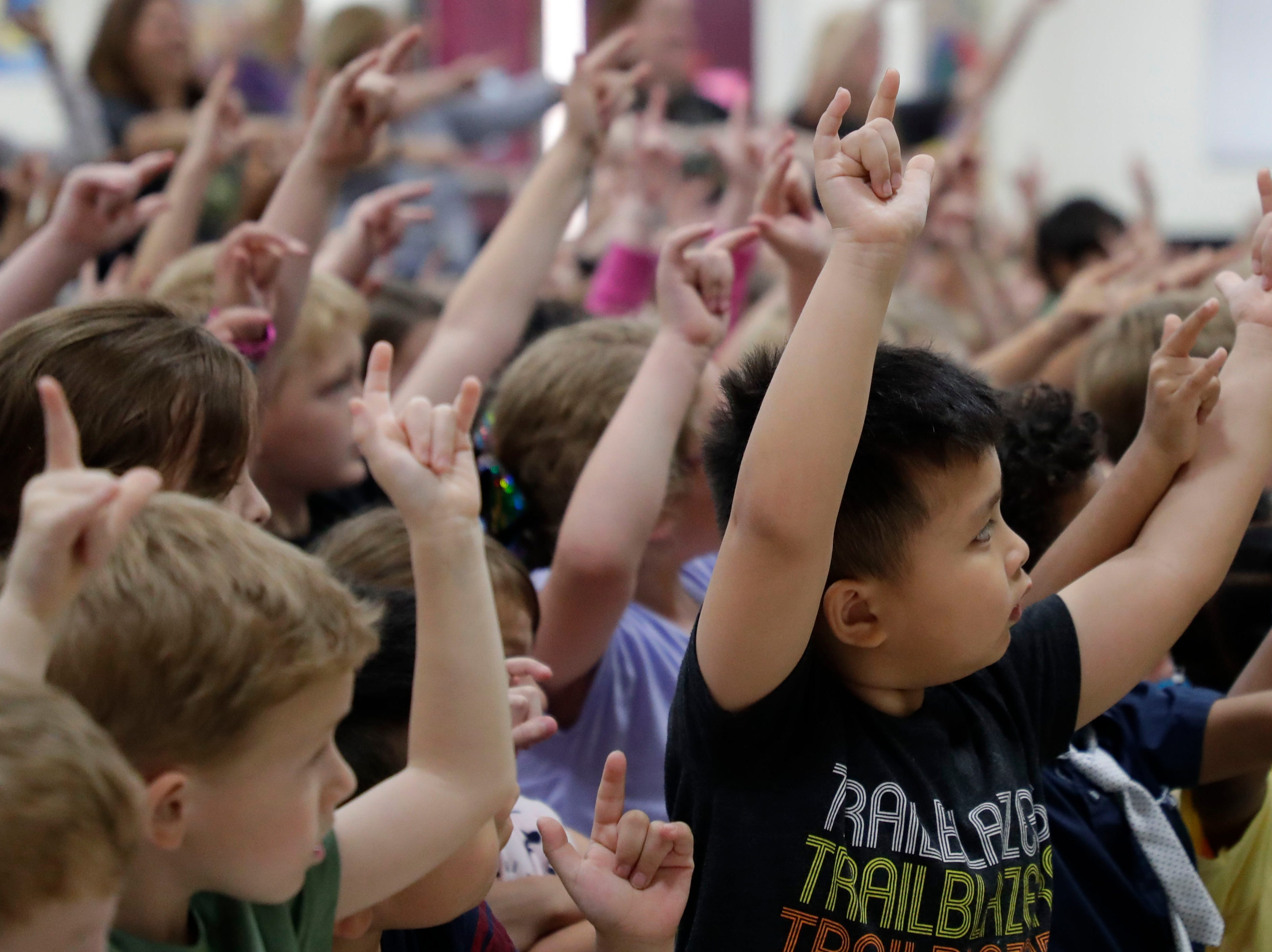"""Students at DeSoto Trail Elementary School rock out with Eric Litwin, the author of the original """"Pete the Cat,"""" performs his books for them Friday, April 12, 2019."""