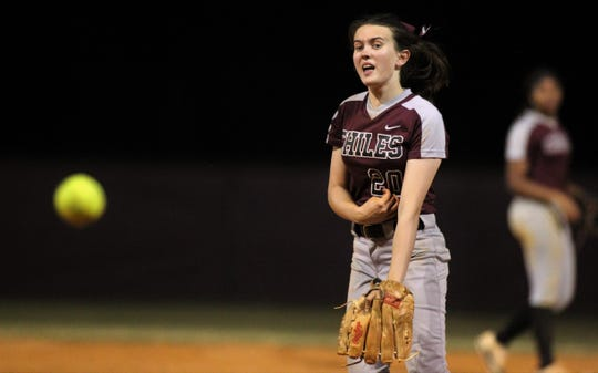 Chiles senior Dani Bauer makes a warm-up pitch without her protective mask as Chiles won 6-1 against visiting Franklin County on Wednesday, April 10, 2019.
