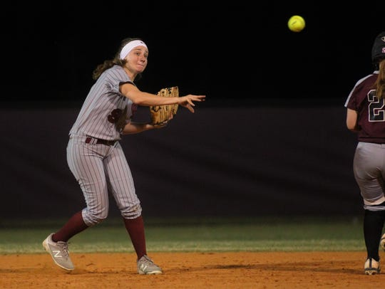 Franklin County shortstop Melanie Collins throws to first for an out as Chiles won 6-1 against visiting Franklin County on Wednesday, April 10, 2019.