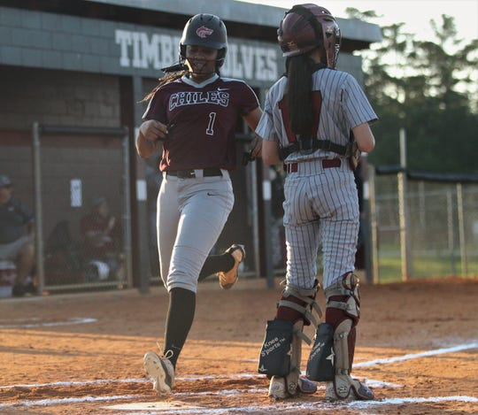 Chiles junior Amaya Gainer scores a run as Chiles won 6-1 against visiting Franklin County on Wednesday, April 10, 2019.