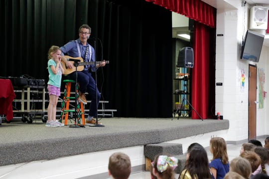 "Eric Litwin, author of the original ""Pete the Cat,"" right, sings a song with DeSoto Trail Elementary School student Riley Bergozza, 6, Friday, April 12, 2019."