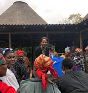 Rosalind in Village in Eswatini demonstrating water filters.