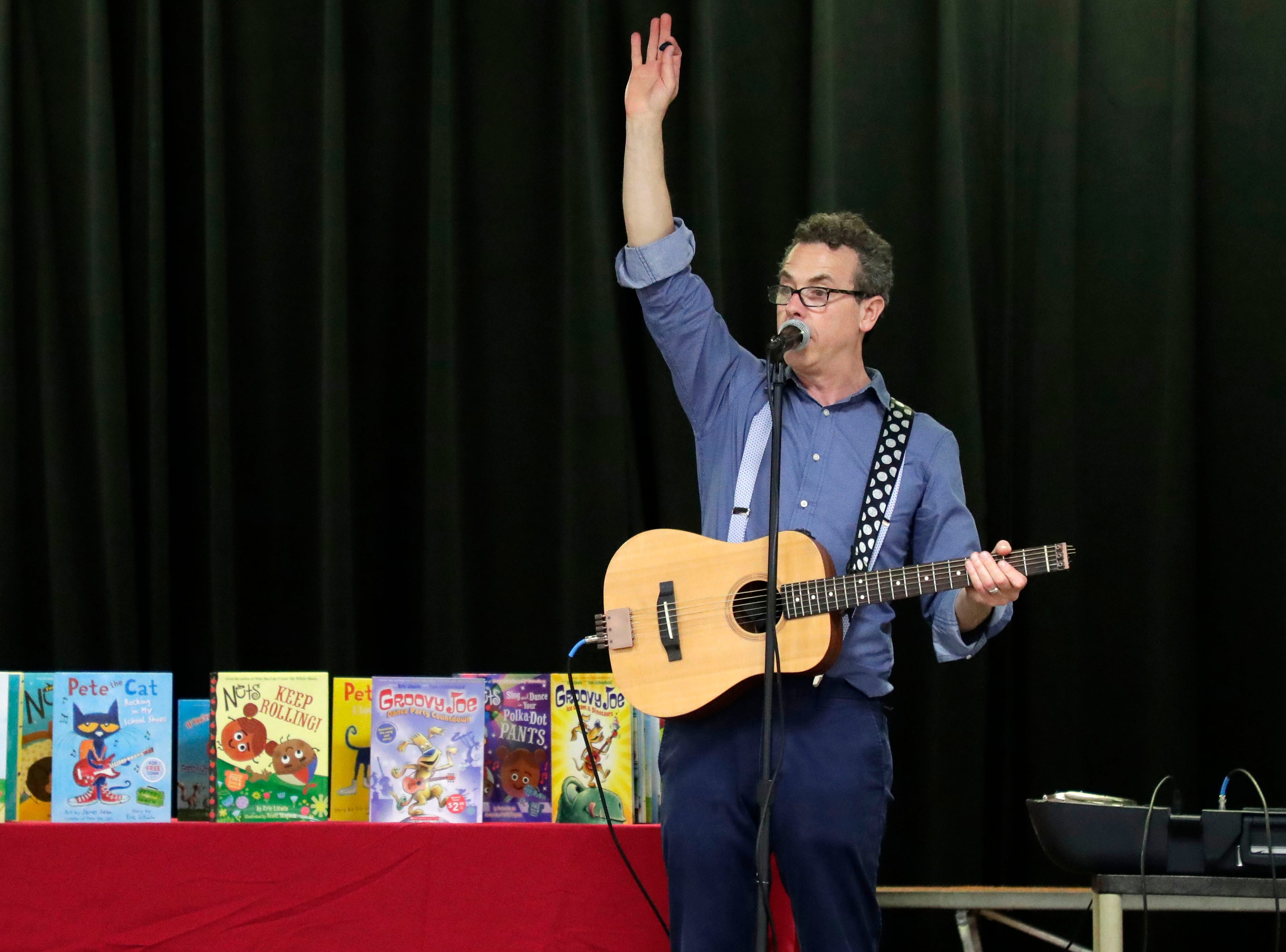 """Eric Litwin, the author of the original """"Pete the Cat,"""" performs at DeSoto Trail Elementary School Friday, April 12, 2019."""