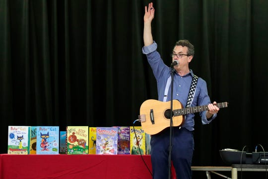 "Eric Litwin, the author of the original ""Pete the Cat,"" performs at DeSoto Trail Elementary School Friday, April 12, 2019."