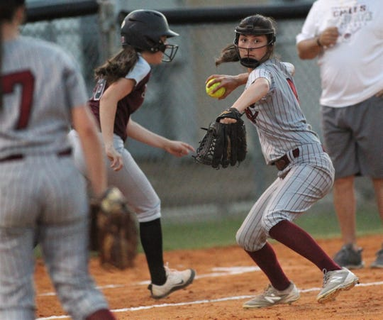 Franklin County third baseman Alexus Johnson throws to first for an out as Chiles won 6-1 against visiting Franklin County on Wednesday, April 10, 2019.