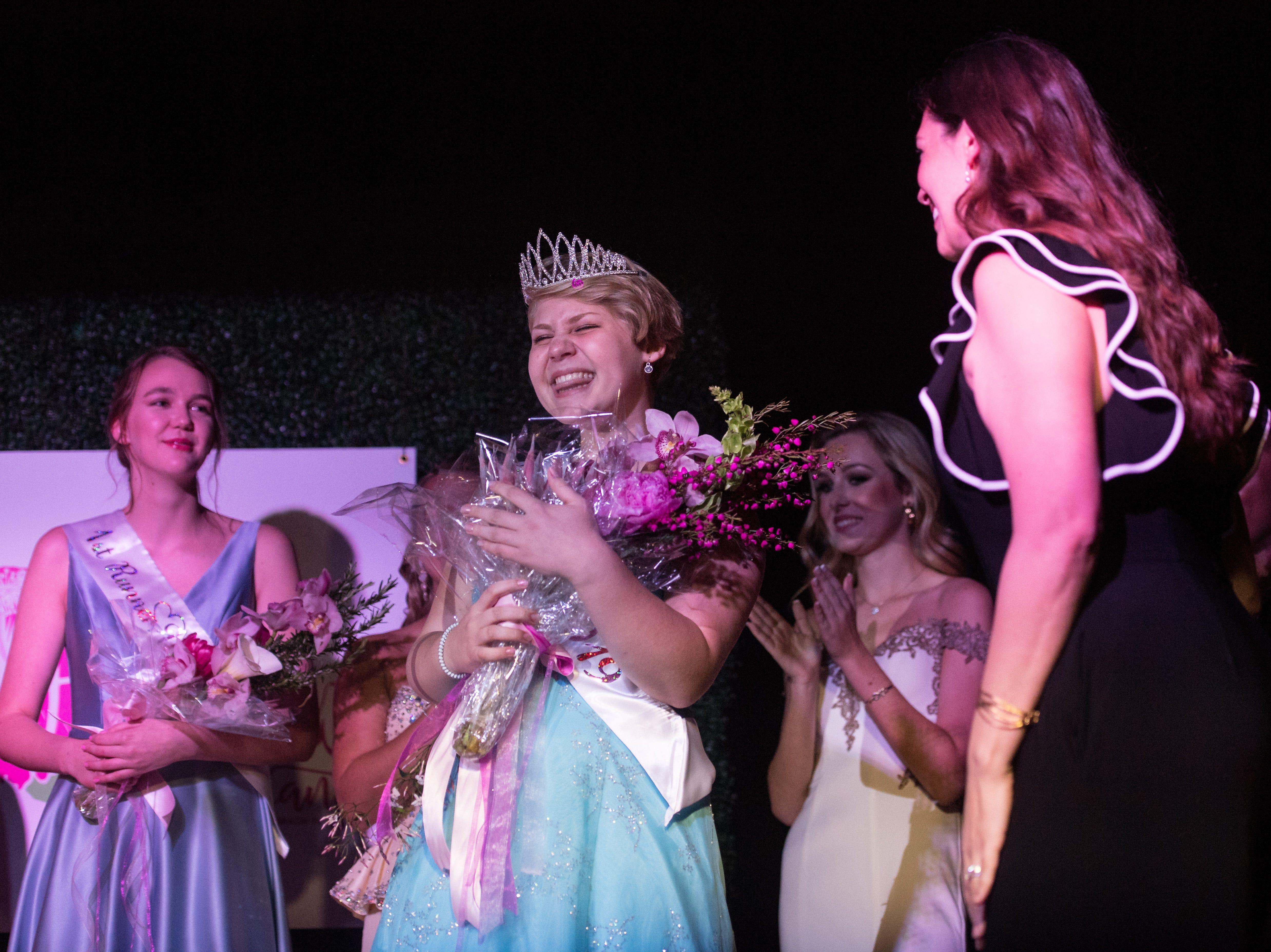 The 2019 Miss Hibiscus Pageant winner Rebekah Parsons (center) reacts with surprise and joy after taking first in the pageant on Thursday, April 11, 2019, at the Heritage Center in Vero Beach.
