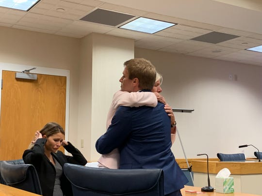 Martin County Commissioner Sarah Heard hugs her lawyer Jordan Wagner after a jury acquitted her of misdemeanor public records violations April 12, 2019. Heard's other attorney Barbara Kibbey Wagner, seated, also assisted during her week-long trial at the Martin County Courthouse.