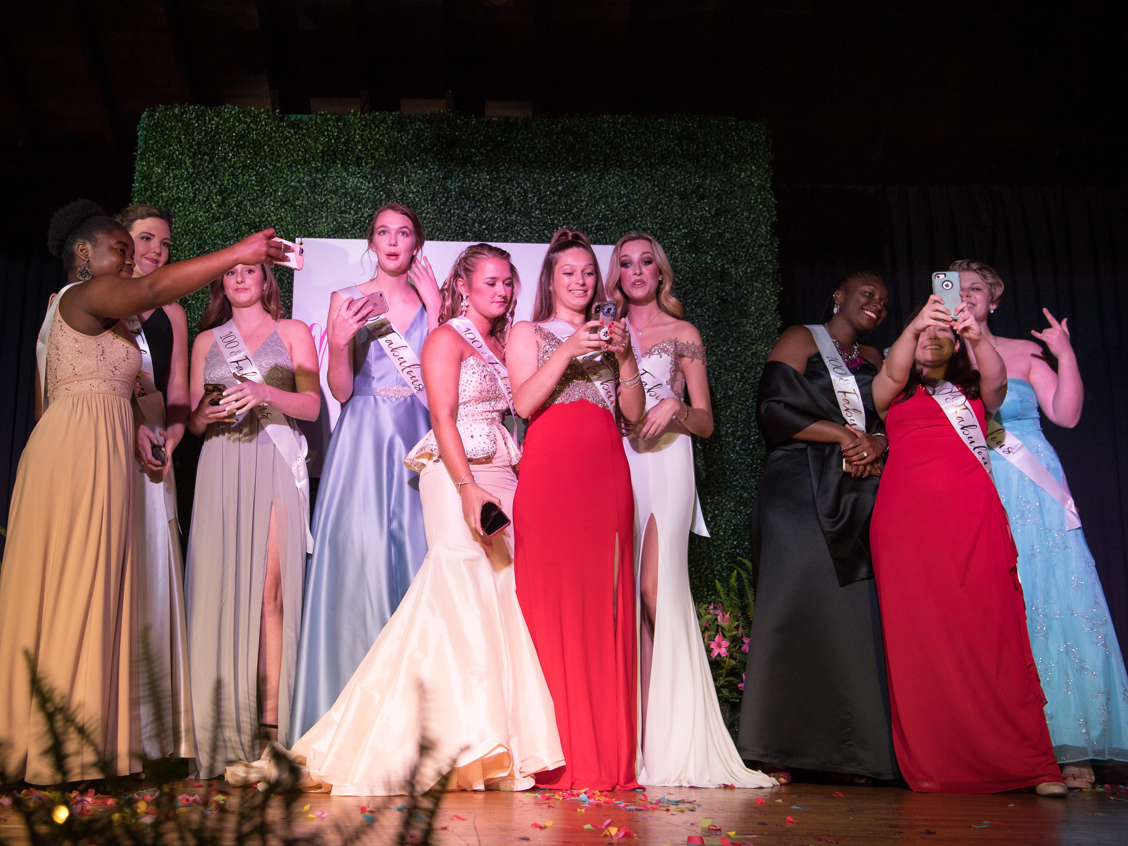 "The ten 2019 Miss Hibiscus Pageant  contestants pose during ""60 seconds of selfies"" onstage at the beginning of the pageant Thursday, April 11, 2019, at the Heritage Center in Vero Beach. ""It's an honor to be able to celebrate these amazing women, and really promote girl power,"" said emcee Cindy Goetz. The contestants (from left) are Unique Edden, Mackenzie Cooley, Kylie Gilbert, Marie Lorenz, Michaela Silvey, Jasmine Murray, Grace Carlon, Alicia Maneiro, Daisy Cabanas and Rebekah Parsons."