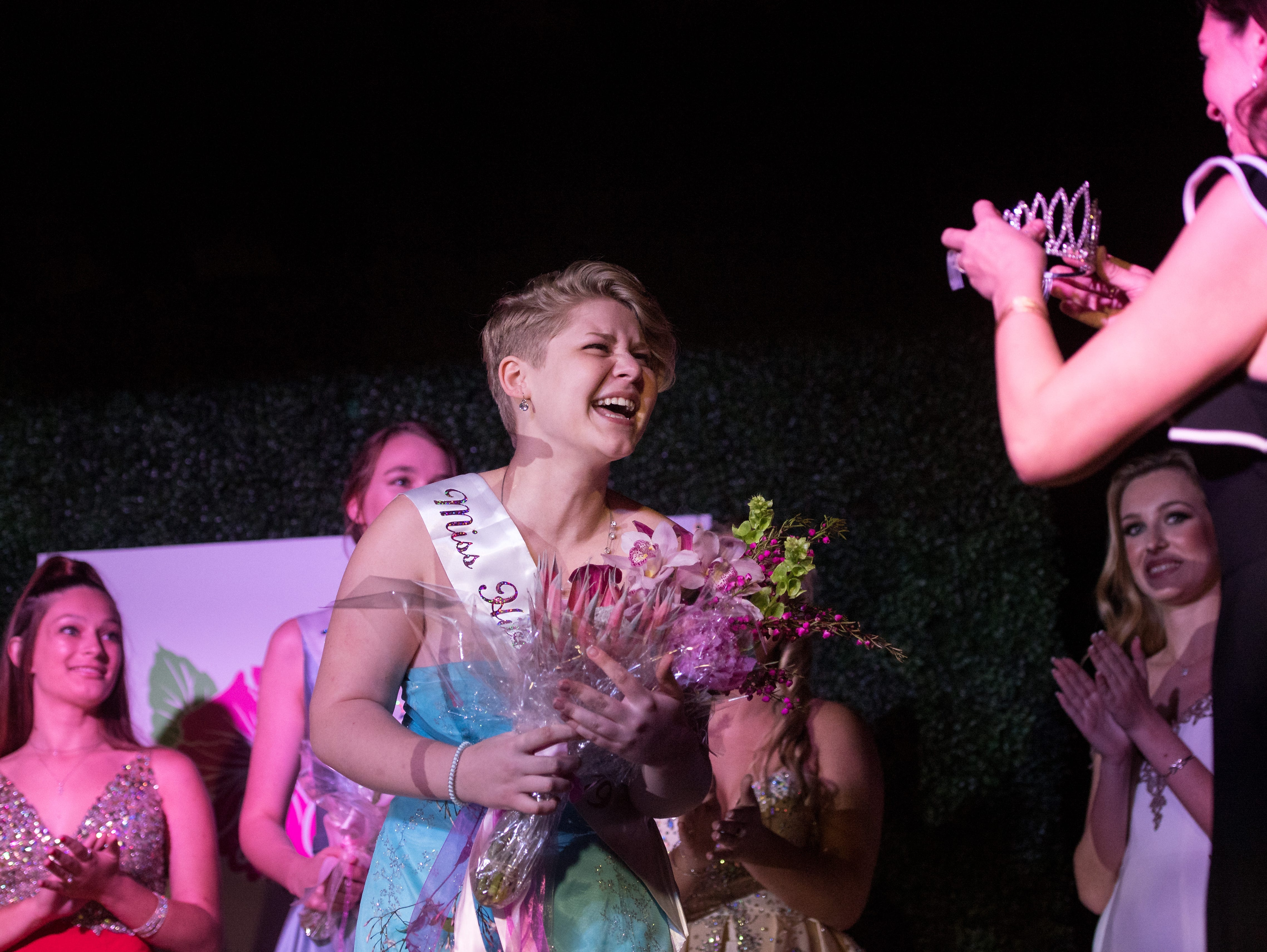 The 2019 Miss Hibiscus Pageant winner Rebekah Parsons (center) is adorned with a tiara after being announced as Miss Hibiscus 2019 on Thursday, April 11, 2019, at the Heritage Center in Vero Beach.