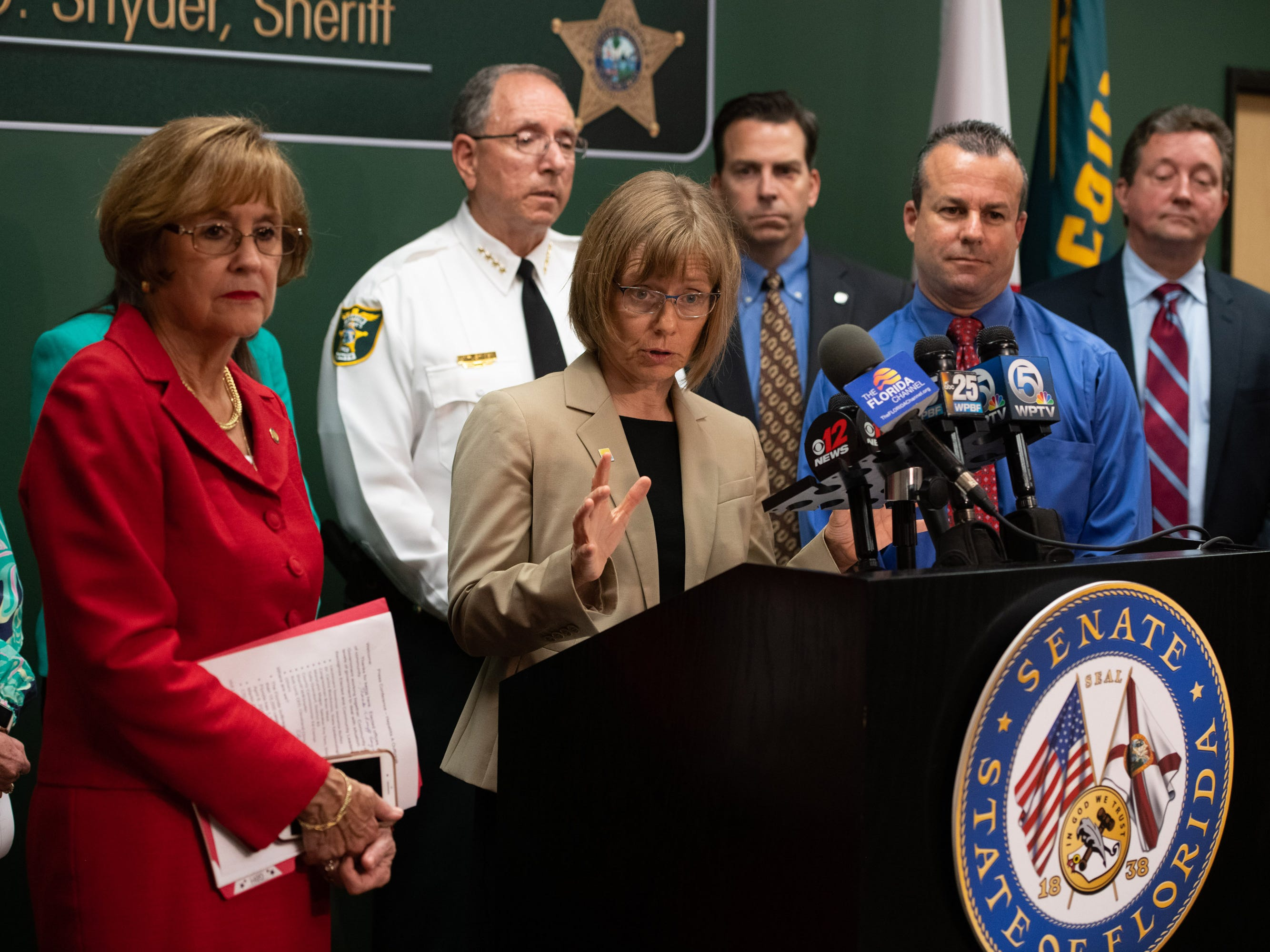 State Epidemiologist Dr. Carina Blackmore (center) speaks at the press conference regarding the recent hepatitis A outbreak in Martin County at Martin County Sheriff's Office on Friday, April 12, 2019, in Stuart.
