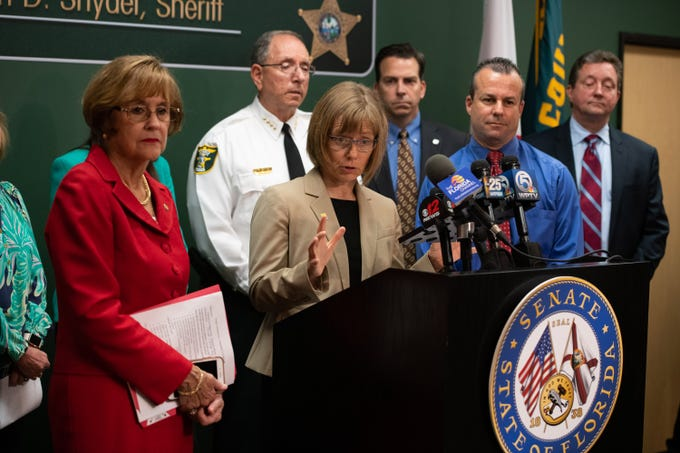 State Epidemiologist Dr. Carina Blackmore (center) speaks at the press conference regarding the recent hepatitis A outbreak in Martin County held at the Martin County Sheriff's Office on Friday, April 12, 2019, in Stuart.
