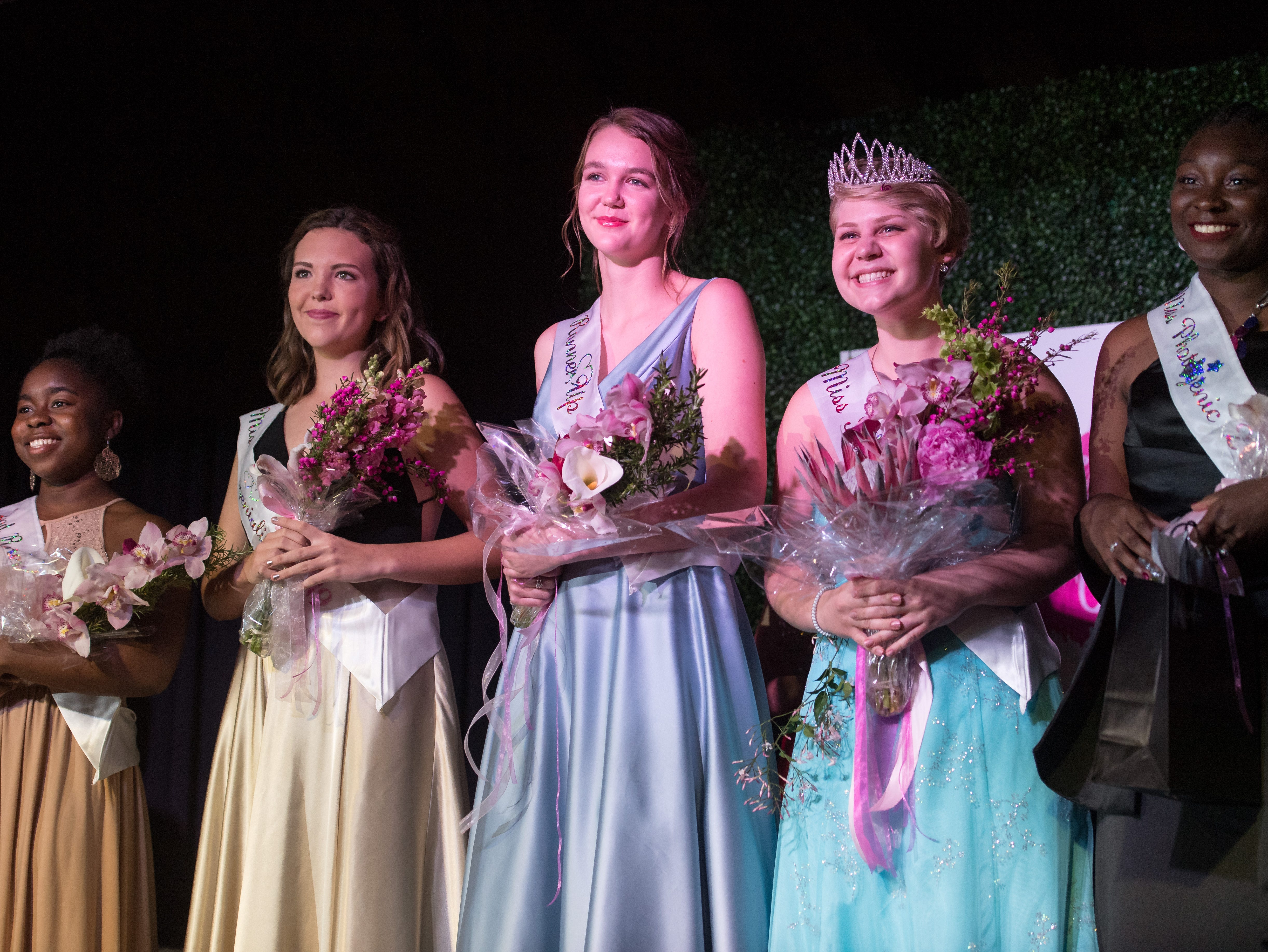 The 2019 Miss Hibiscus Pageant court (from left), second runner-up Unique Edden, Miss Congeniality Mackenzie Cooley, first runner-up Marie Lorenz, Miss Hibiscus 2019 Rebekah Parsons and Miss Photogenic Alicia Maneiro, pose for photos onstage Thursday, April 11, 2019, at the Heritage Center in Vero Beach.