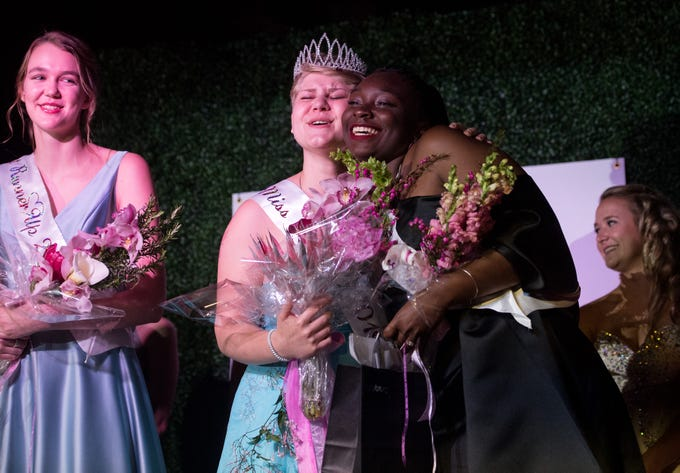 "The 2019 Miss Hibiscus Pageant winner, Rebekah Parsons (center), is embraced by Miss Photogenic Alicia Maneiro, as first runner-up Marie Lorenz stands at left, after they were all awarded onstage Thursday, April 11, 2019, at the Heritage Center in Vero Beach. ""I didn't know what to expect coming into this pageant,"" Parsons said, exclaiming her surprise at winning. ""I've never seen so many people with so much love,"" she added, expressing gratitude to the other participants. The pageant, which is a Main Street Vero Beach project, is part of the weekend long Hibiscus Festival in downtown Vero Beach."