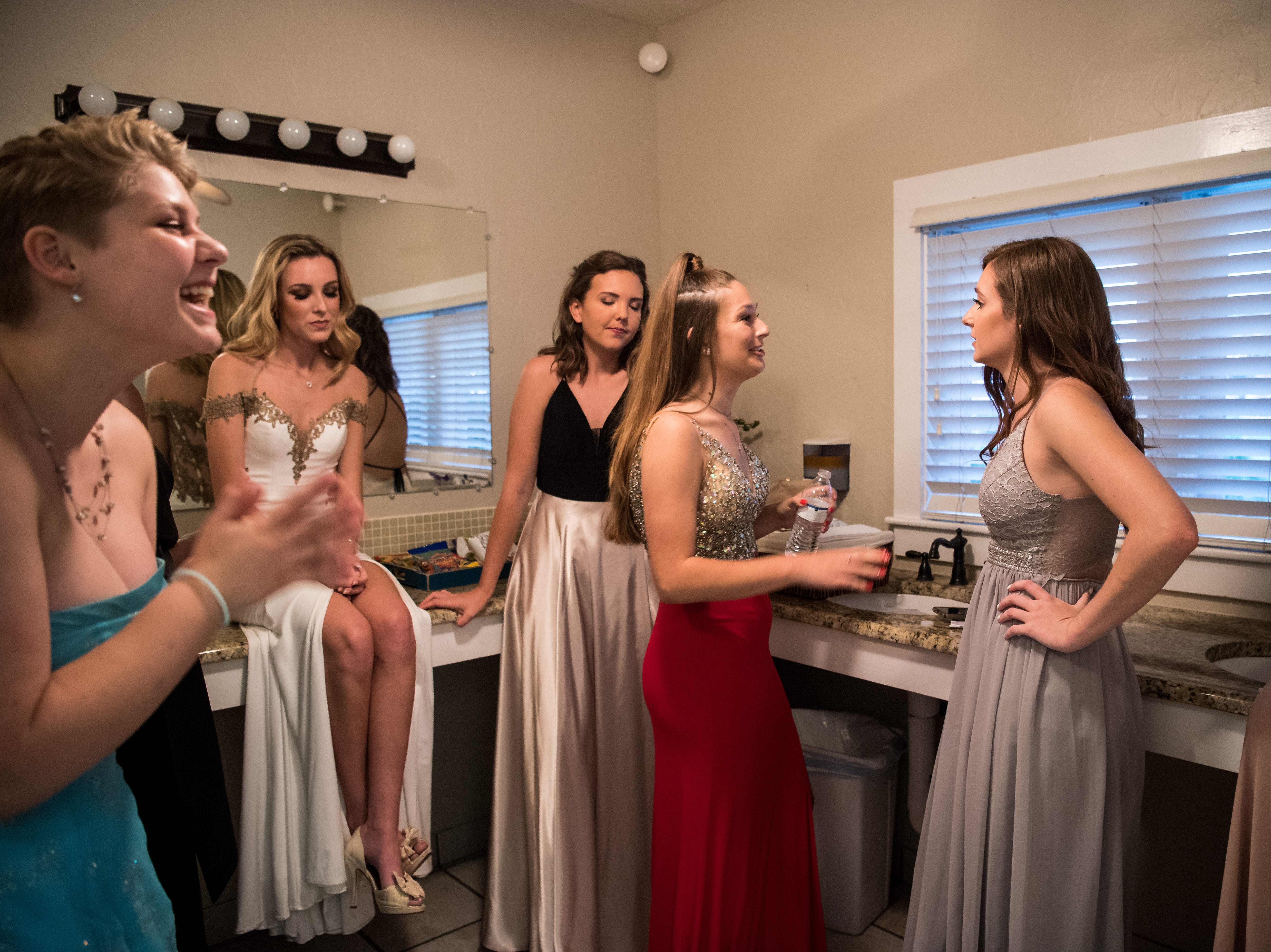 Excited, nervous and otherwise occupied 2019 Miss Hibiscus Pageant contestants socialize offstage Thursday, April 11, 2019, at the Heritage Center in Vero Beach.