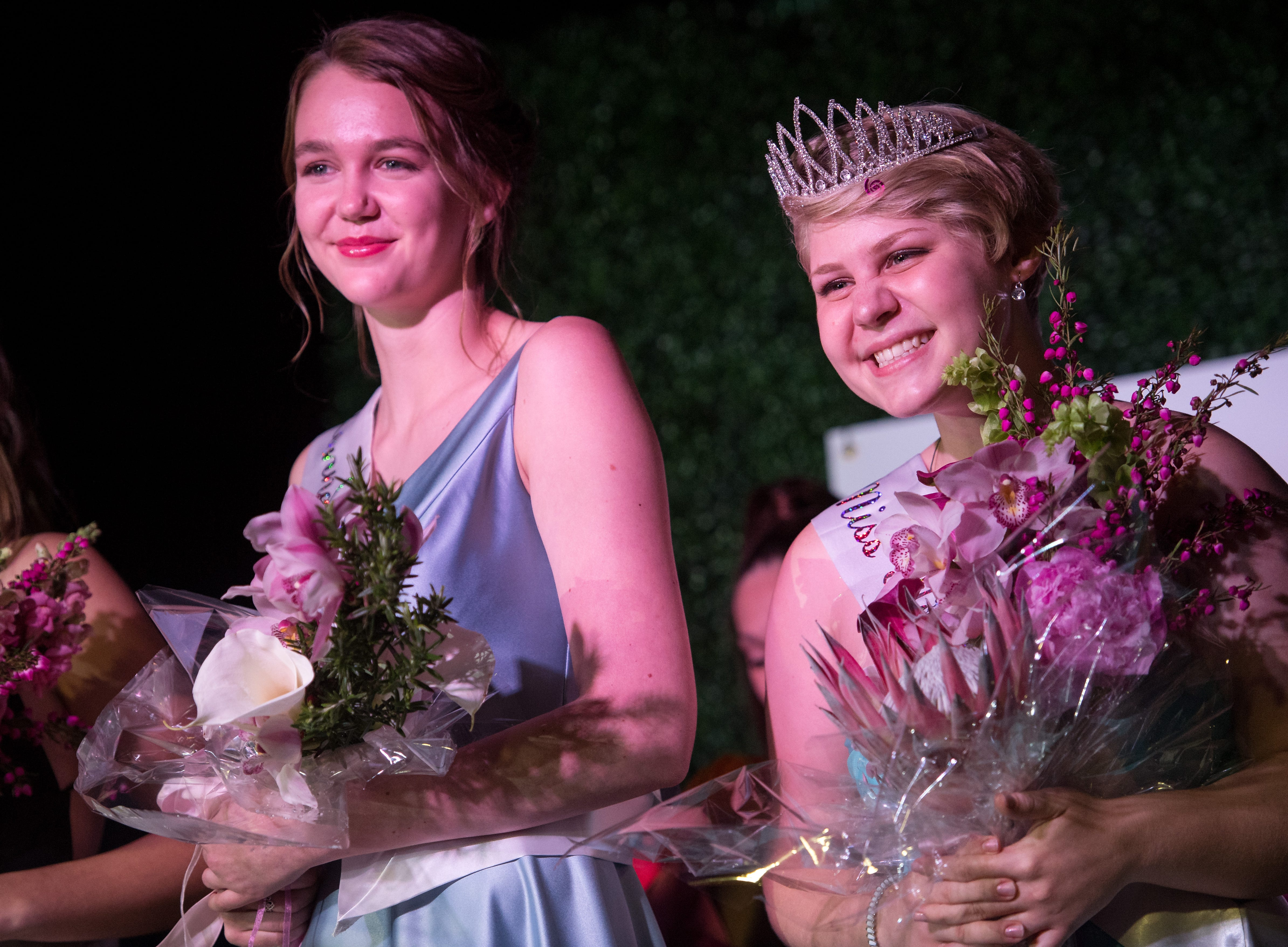 "The 2019 Miss Hibiscus Pageant winner Rebekah Parsons (right) poses for a photo alongside first runner-up Marie Lorenz after being crowned Thursday, April 11, 2019, at the Heritage Center in Vero Beach. ""I didn't know what to expect coming into this pageant,"" Parsons said, exclaiming her surprise at winning. ""I've never seen so many people with so much love,"" she added, expressing gratitude to the other participants. The pageant, which is a Main Street Vero Beach project, is part of the weekend long Hibiscus Festival in downtown Vero Beach."