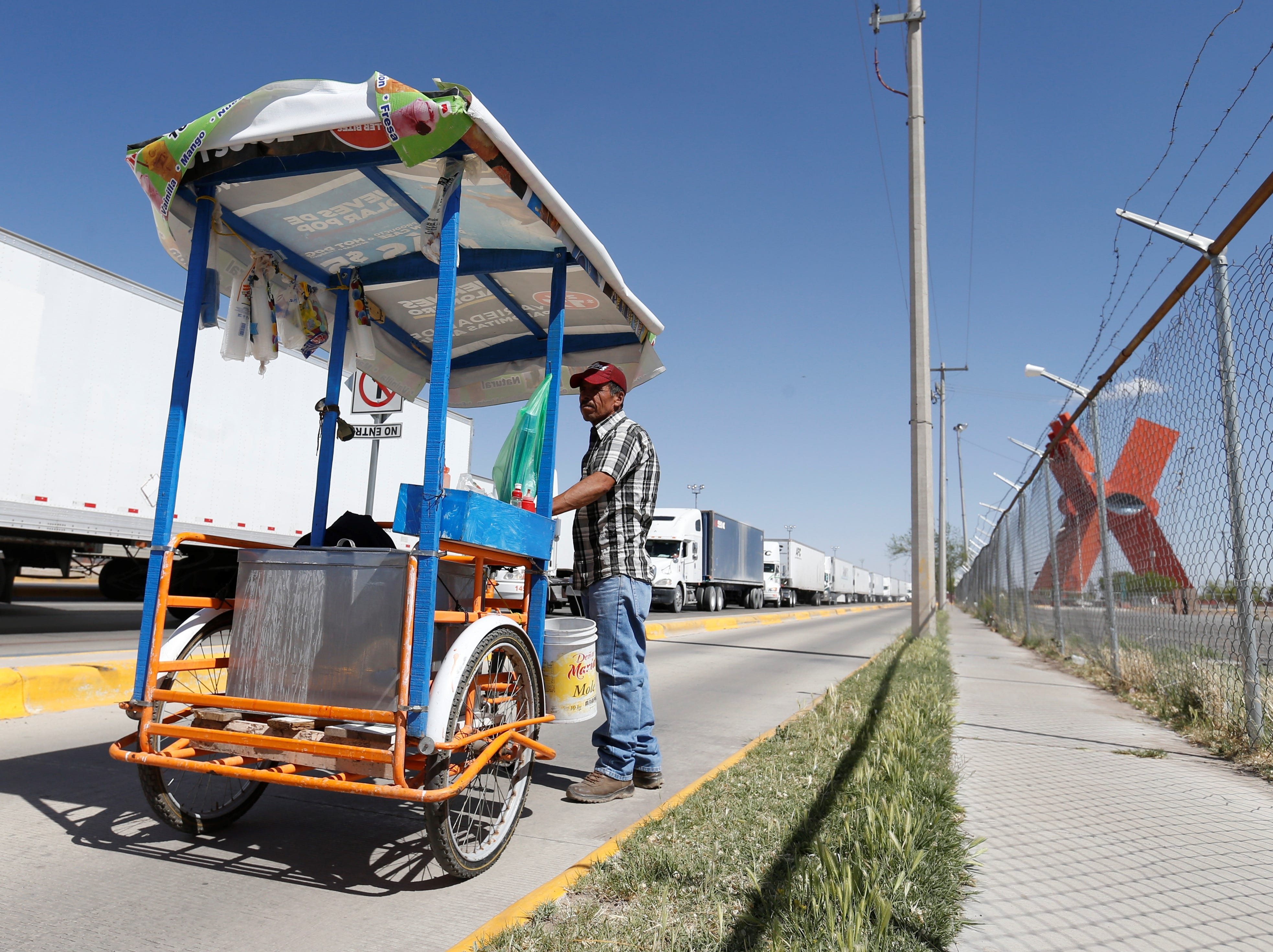 Street food vendors feed commercial truck drivers as they wait to cross the U.S.-Mexico border.