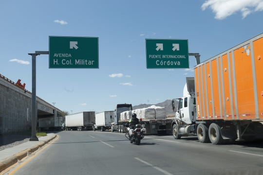 Long lines of commercial trucks line Juárez's Juan Pablo II Boulevard as they wait to cross the international Bridge of the Americas into El Paso. Some drivers have waited a day to cross.