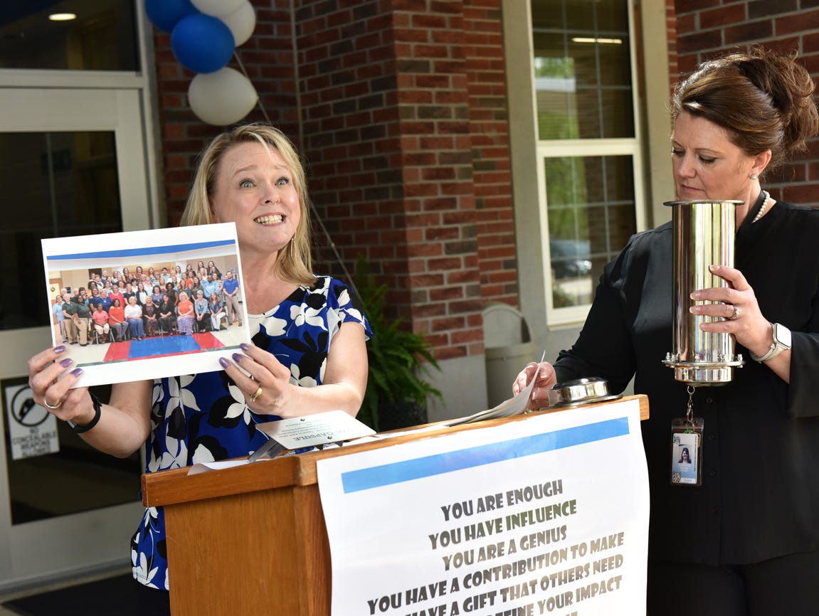 Lara Fernicola, the Michelin Lisason and Parent and Family Engagement Coordinator at Sue Cleveland Elementary, left, and school principal Christie Early, display items that were to be placed in a time capsule during the Michelin Challenge Education 10th Anniversary Celebration held at the school on Friday, April 12, 2019.