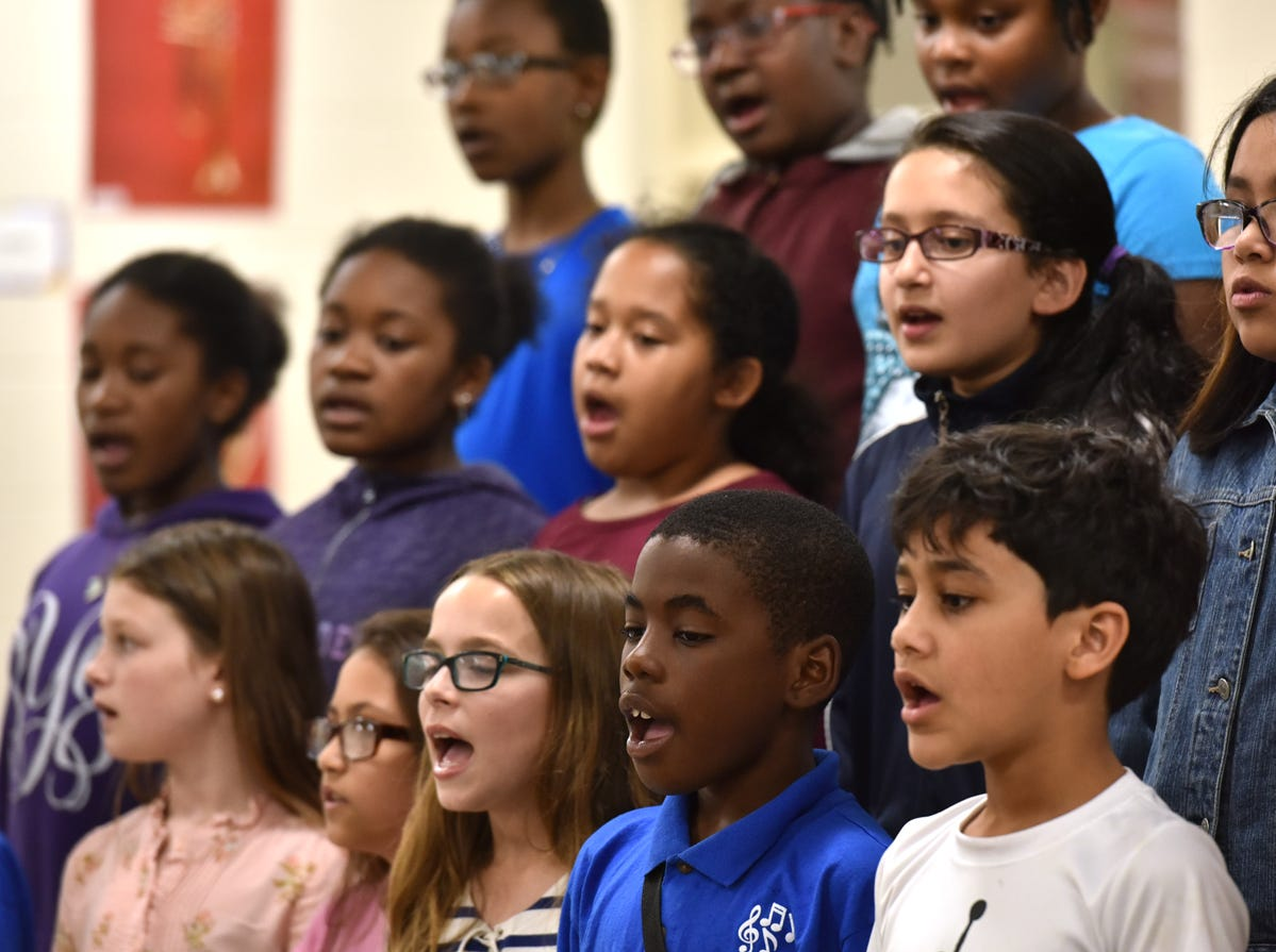 The Sue Cleveland Elementary School choir performs during the Michelin Challenge Education 10th Anniversary Celebration held at the school on Friday, April 12, 2019.
