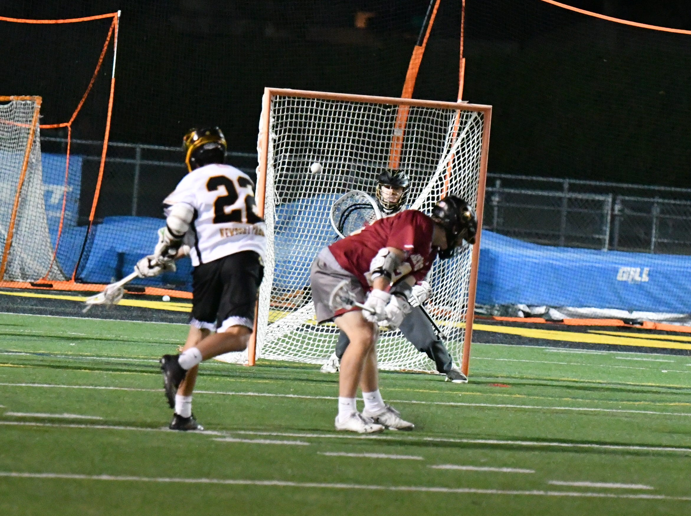 Newbury Park's Connor Vitto lets a shot rip against Oaks Christian goalie Mikey Thompson in a Marmonte League boys lacrosse game on March 20. Oaks Christian won, 8-2.