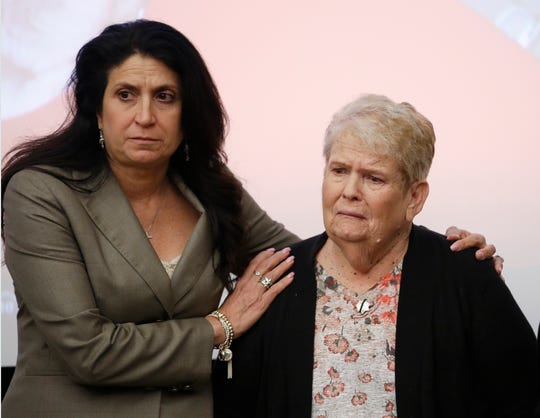 Jeri Oliver, right, whose son Danny Oliver was killed while on duty as a Sacramento County sheriff's deputy, is comforted by Nina Salarno Besselman, president of Crime Victims United of California after calling call on Gov. Gavin Newsom to reverse his moratorium on executions.