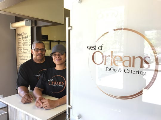 The husband-and-wife team of Marcus and Trissa Webster pose at the order counter of West of Orleans, their food-to-go and catering kitchen in Newbury Park.