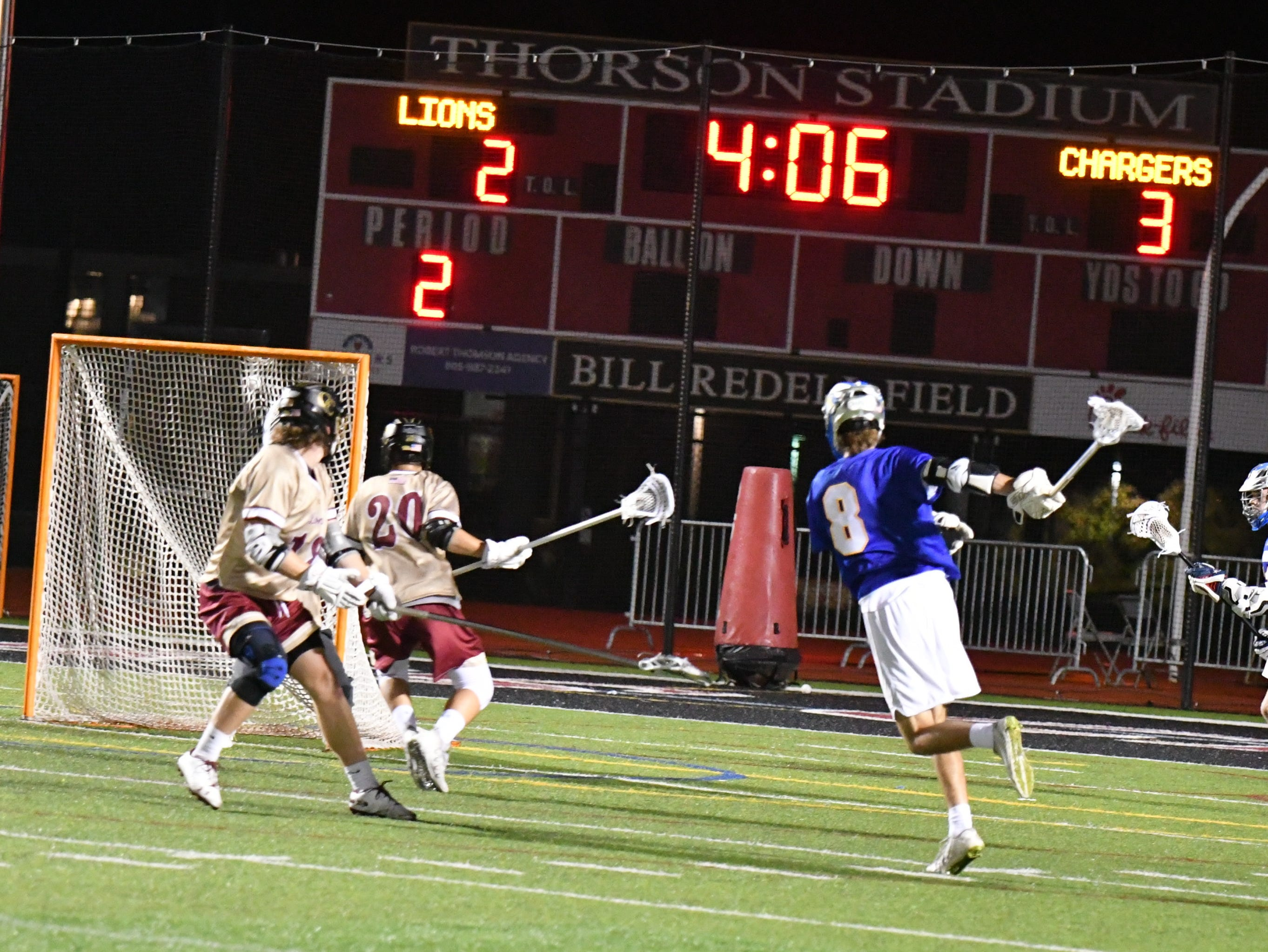 Agoura's Boaz Conrad fires a shot at the Oaks Christian goal, protected only by defender Cooper Schulze (20), during the teams' triple-overtime thriller on March 6. Oaks Christian won, 8-7.
