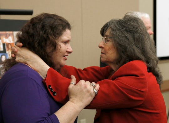 Sandy Friend, the mother of 8-year-old murder victim Michael Lyons, left, and Raquel Herr, the mother of murder victim Sam Herr, comfort each other after a Sacramento news conference to call on Gov. Gavin Newsom to reverse his moratorium on executions.
