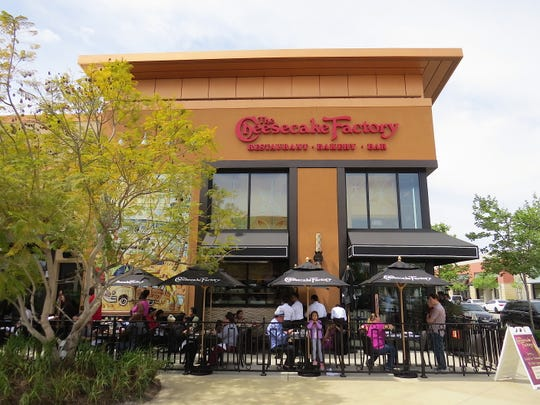 Diners attend a pre-opening lunch service on the patio at The Cheesecake Factory at The Collection at RiverPark in Oxnard. The restaurant will open to the public on April 16.