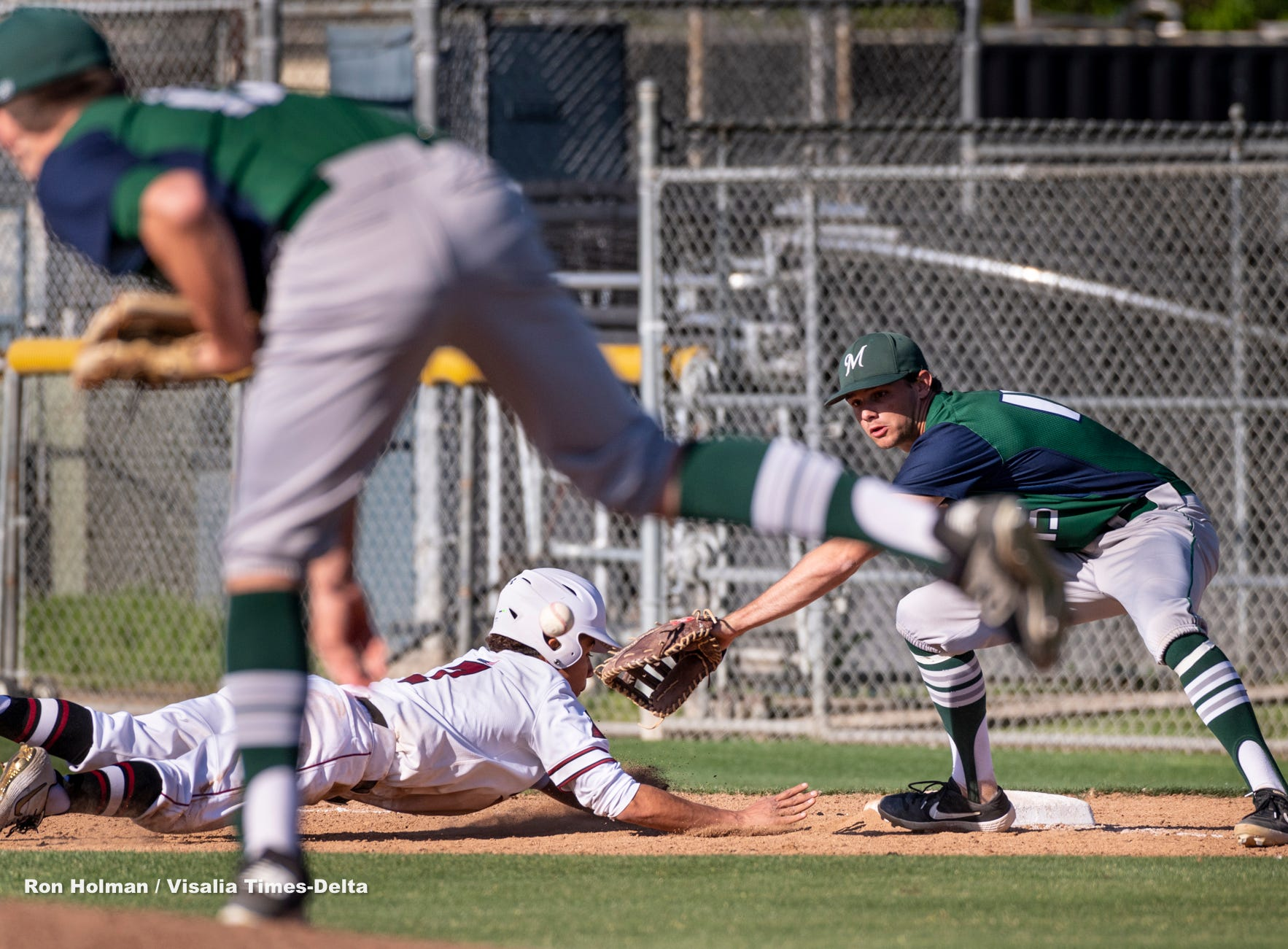 Mt. Whitney's Rolando Luna gets safely back to first during a pick-off attempt by El Diamante pitcher Riley Creech and Parker Boswell on Wednesday, April 10, 2019.