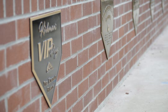 The major sponsors behind the Lions Stadium renovation project were each recognized with a plaque behind the back stop.
