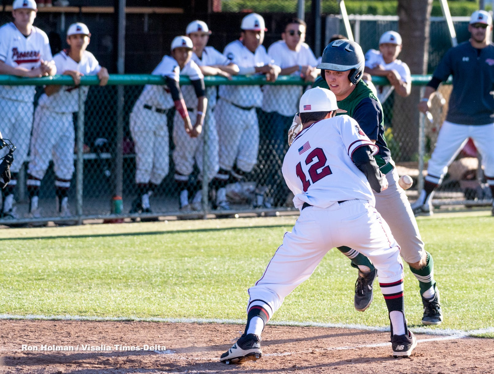 El Diamante's Austin Beno gets by /mw12/ to score the winning run against Mt. Whitney on Wednesday, April 10, 2019.