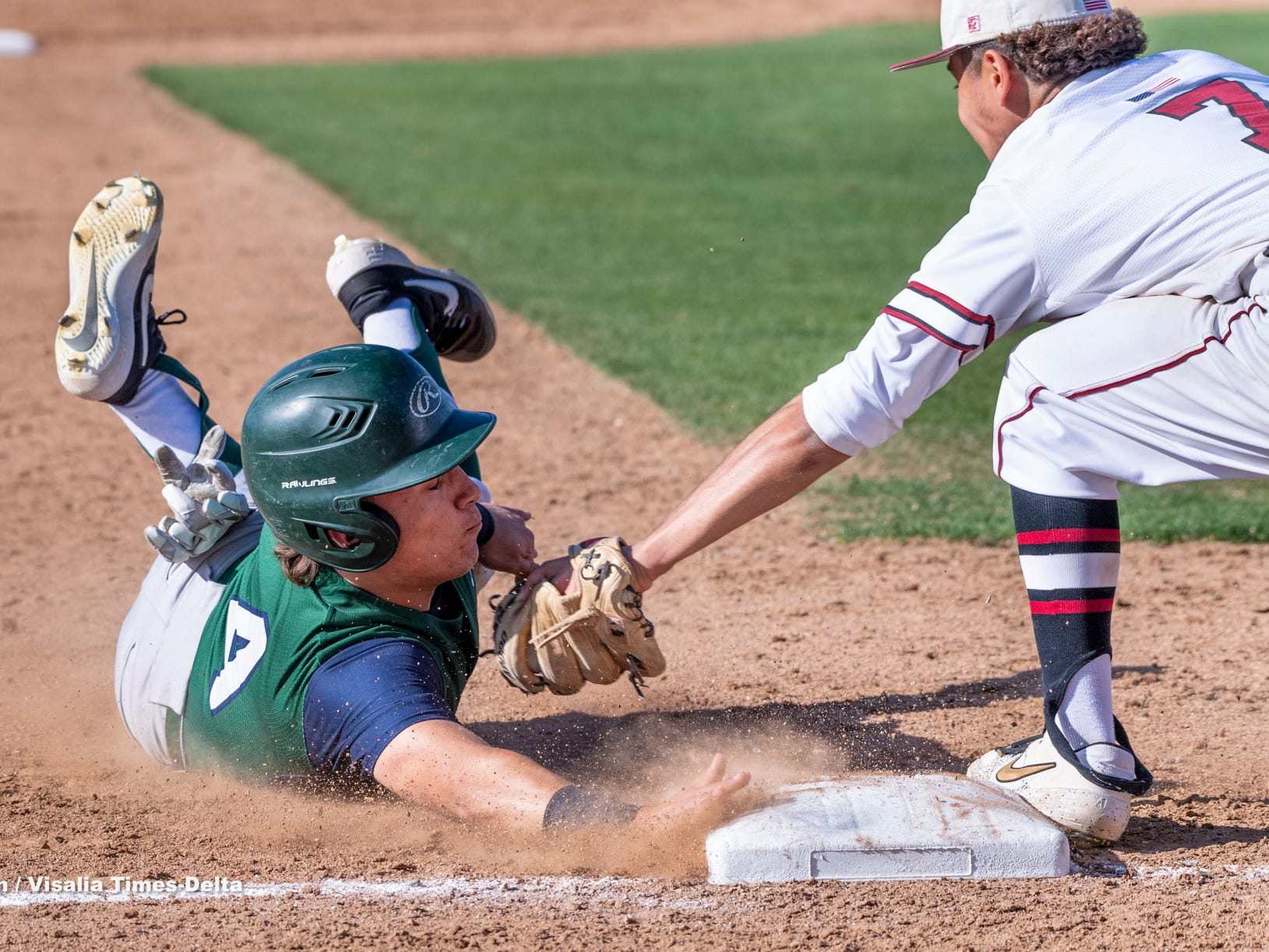 Mt. Whitney's Rolando Luna tags El Diamante's Tyler Ritter at third on Wednesday, April 10, 2019. He was called out on the play.
