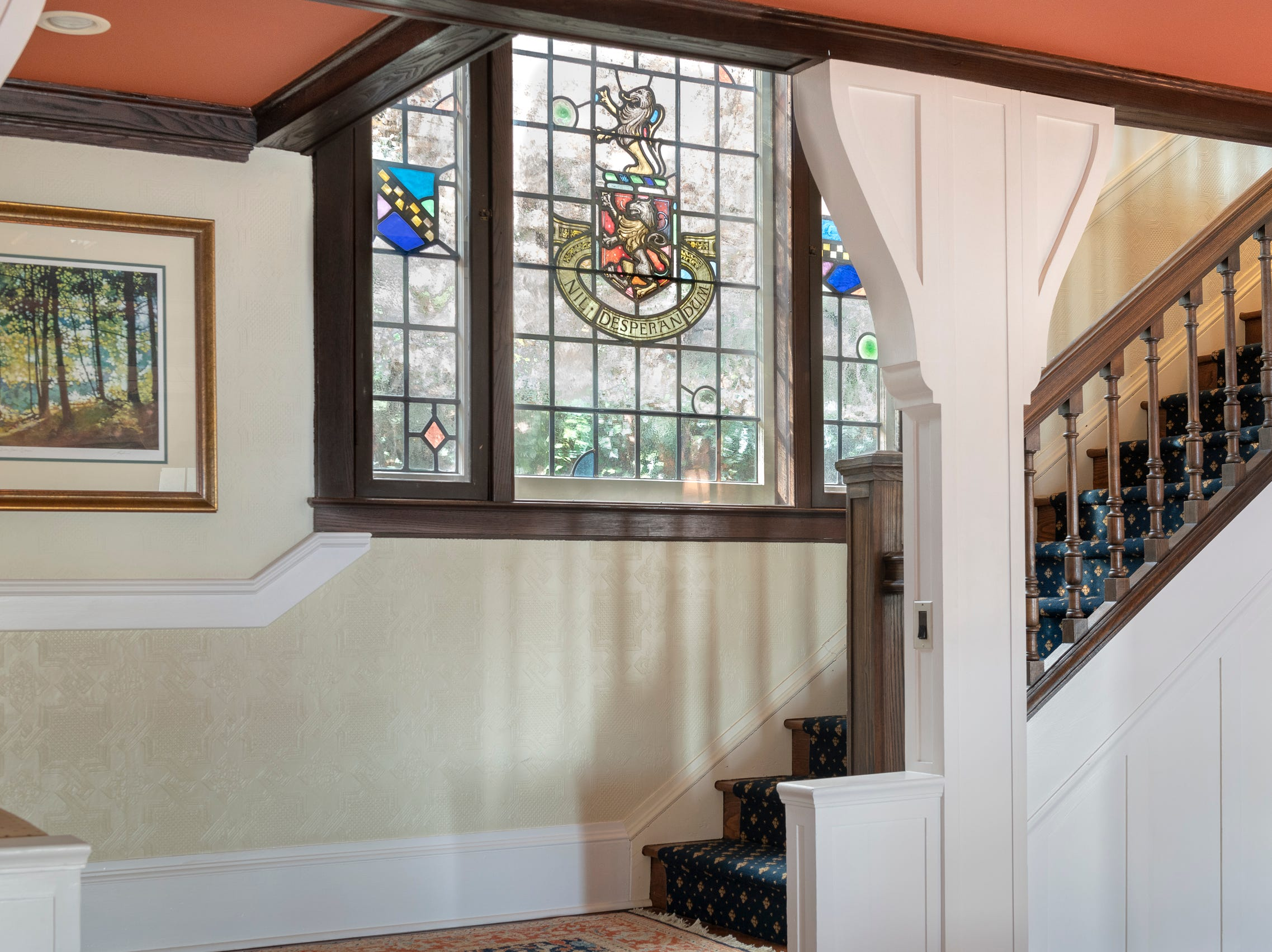 The formal entry staircase has original stained glass panels.