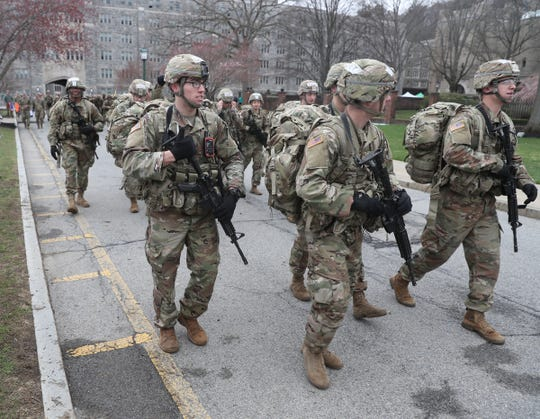 Cadet Brady Miller, left, from Glen Rock, N.J. heads to the startingline for the start of the Sandhurst Military Skills Competition at Unites States Military Academy at West Point on Friday, April 12, 2019.