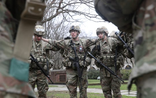 Cadet Brady Miller, center, from Glen Rock, N.J. talks with his squad prior to the start of the Sandhurst Military Skills Competition at Unites States Military Academy at West Point on Friday, April 12, 2019.